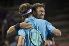 Artem Sitak, facing camera, hugs Marcus Daniell during a win at the ASB Classic. photo / Nick Reed