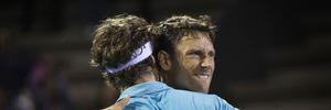 Artem Sitak, facing camera, hugs Marcus Daniell during a win at the ASB Classic. photo / Nick Reed