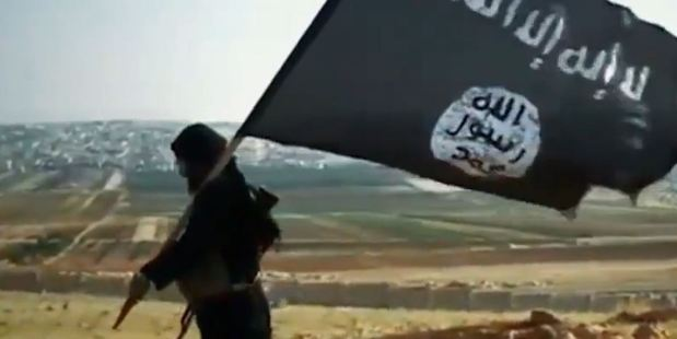 The latest killing video from Isis (Islamic State) features a blond-haired Frenchman. Photo of Isis flag / YouTube