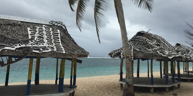 Offcuts from the manufacture of jandals adorn the roofs of beachside fale