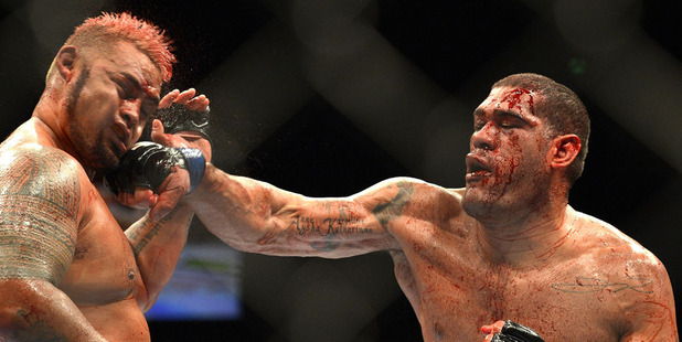 Mark Hunt is hit by Antonio 'Big Foot' Silva during their 2013 bout. Photo /Getty