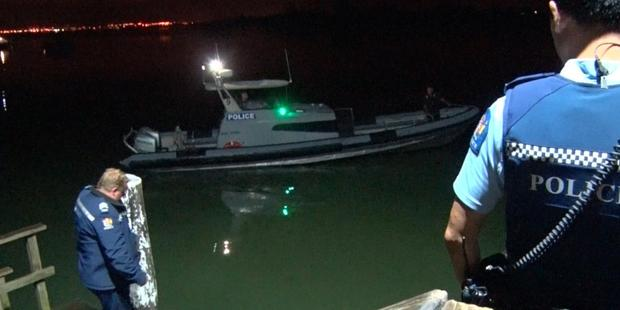 Loading Police boats were called in to search for the missing swimmer. Photo / Daniel Hines