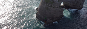 The pair were spotted waving and clinging to a rock. Photo / NELSON MARLBOROUGH RESCUE HELICOPTER