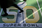 People walk across a Super Bowl 50 logo as they attend an attraction at Super Bowl City in San Francisco. Photo / AP