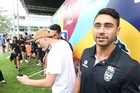 Returning Warriors halfback Shaun Johnson was mobbed like a rock star as thousands of league supporters descended on central Auckland yesterday to party with their sporting heroes.