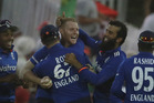 England players celebrate with Ben Stokes after his one-handed catch. Photo / AP
