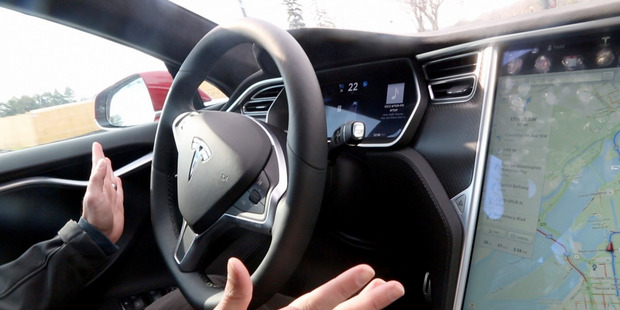 Look, Ma, no hands! Tesla's autopilot mode allows the car to essentially drive itself for long periods of time, from traffic jams to highway cruises. Photo / Washington Post