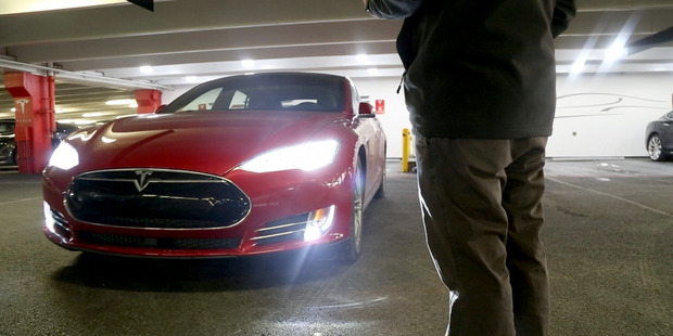 Tesla recently issued a software update that equipped its vehicles with Summon, the ability for Teslas to drive short distances autonomously. Photo / Washington Post