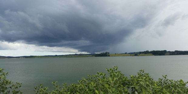 Loading Thunder and lightning seen in the Kaipara Harbour this afternoon. Photo / Supplied by Karyn Froud