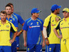 Australian cricketers look on after being thrashed at Eden Park. Photo / Getty