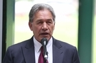 New Zealand First Leader Winston Peters discusses TPP during a rally in Pahia.