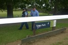 Police inspect a damaged sign at Yates Park after three men were shot. Photo / Simon Collins