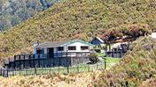 The pa-style setting of the whare on Te Kai Waho. Photo / John Bishop