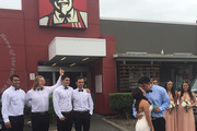 The picture of the happy couple in front of Colonel Sanders' face has gone viral. Photo / Supplied