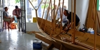 Ulf Mikalsen, from Norway's far north, works on a traditional Norwegian boat in a shop on Russell's York St.