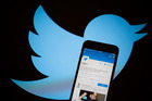 Twitter has tweaked its timeline to be more like Facebook's in a bid to get new users hooked. Photo / Bloomberg