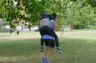 Sam Morgan jumps on the back of Art Green while jogging in Victoria Park. Photo/WatchMe