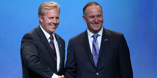 New Zealand Minister of Trade Todd McClay with New Zealand Prime Minister John Key after signing the Trans Pacific Partnership at Sky City. Photo / Getty Images