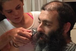 Hamish MacMillan's daughter Emily gets a turn shaving her dad's beard.
