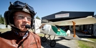 DECO WINGS: Havelock North's Brian Anderson and his deco-inspired replica of a 1926 German biplane. Photo / Warren Buckland
