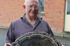 Joe Dodunski, president of the Woodville-Pahiatua Racing Club with a silver salver found after being missing for 60 years. Photo / Christine McKay