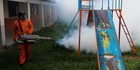 A city worker fumigates for Aedes aegypti mosquitoes at a school playground. AP photo / Juan Karita