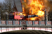 A bus explodes on Lambeth Bridge in London during filming for Jackie Chan's new film The Foreigner. Photo / AP