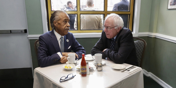 Bernie Sanders sits down for breakfast with the Rev Al Sharpton at Sylvia's Restaurant in Harlem.
