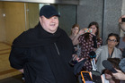 Kim Dotcom fronts media after appearing in Auckland District Court for the decision on his extradition. Photo / Nick Reed