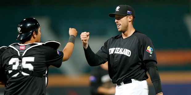 Beau Bishop #35 and Lincoln Holdzkom #17 of Team New Zealand celebrate in the 2013 World Baseball Classic Qualifier. Photo / Getty Images