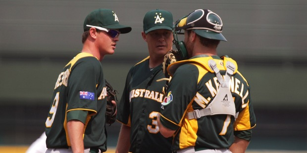 Australian team confers during the World Baseball Classic. Photo / Getty Images