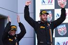 Shane van Gisbergen and Alvaro Parente celebrate on the podium. Photo / Getty Images