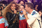 Beyonce and Chris Martin sing together during Coldplay's Super Bowl half time show. Photo/Getty