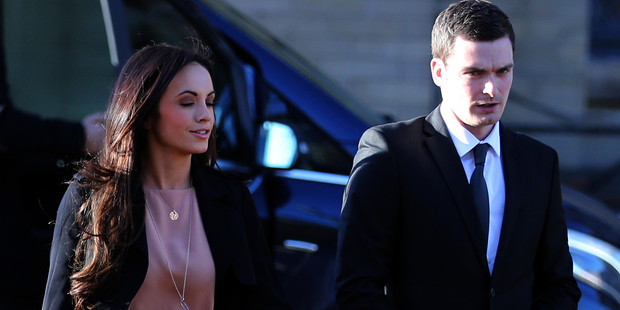Adam Johnson and his partner Stacey Flounders arrive at court. Photo / Getty Images