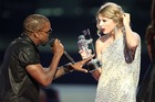 Kanye West jumps onstage after Taylor Swift won the Best Female Video award during the 2009 MTV Video Music Awards. Photo / Getty Images
