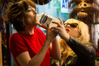 Dakota Johnson and Rebel Wilson in a scene from the movie How To Be Single.