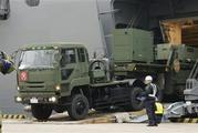A vehicle carrying a PAC-3 missile interceptor arrives at a port on Ishigaki Island, Okinawa prefecture, southwestern Japan. Photo / AP