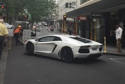 A black Mercedes-Benz rolled into a parked Lamborghini Aventador on Auckland's High St today, apparently after the Mercedes driver struggled to reach for a parking machine. Photo / Supplied