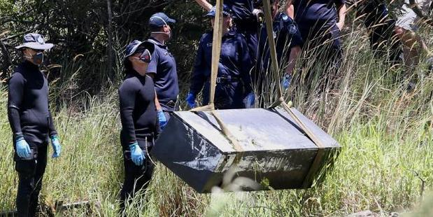 The makeshift coffin had holes drilled in the sides to help it sink. Photo / Jono Searle / News Corp Australia