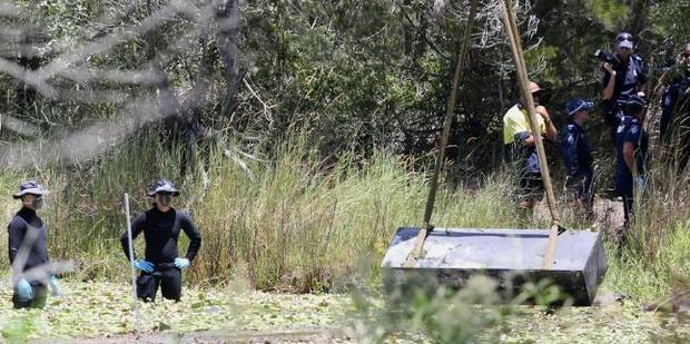 The pair had been beaten, tied up and stuffed in the box before it was driven to the creek. Photo / Jono Searle / News Corp Australia