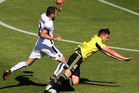 Dylan Fox of the Phoenix is brought down in the challenge of Gyorgy Sandor of the Glory during the round 18 A-League match between Wellington Phoenix and Perth Glory. Photo / Getty,