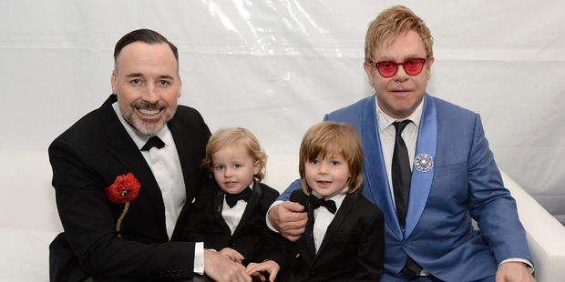 David Furnish and Elton John with their sons Elijah and Zachary. Photo / AP