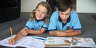Reading is the focus of homework for Lucy and Dylan Henderson. Photo / Doug Sherring