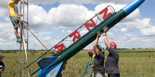 Loading Jack Davies (obscured) gets help during preparations to launch his rocket in Huntly yesterday. Photo / Alan Gibson
