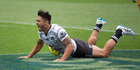 NZ Warriors Shaun Johnson celebrates after getting the winning try against Brisbane Broncos. Photo / Brett Phibbs.