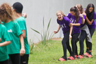 Hannah Sadd (front) and fellow members of Rise Dance Company having some fun at Youth Centre Waitangi Festival before their performance on stage. Photo / Stephen Parker