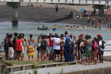 Whanau and friends of the Raglan 16-year-old gather opposite the footbridge from which he jumped. Photo / Alan Gibson