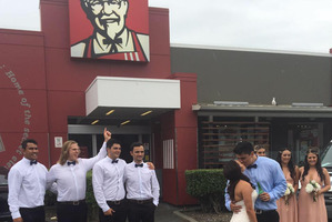 The picture of the happy couple in front of Colonel Sanders' face