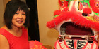 LAVISH AND COLOURFUL: Eileen Ng and her dragon-wielding husband Raymond prepare to celebrate the Chinese New Year.