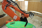 Kinaroad chief executive Scott Fenton says his surf board shaping robots can produce 7000 boards a year. Photo / Supplied